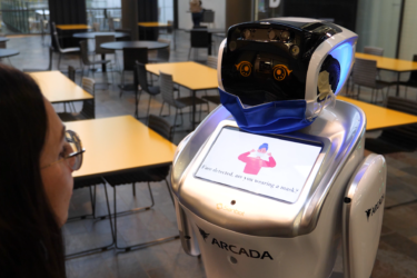 Picture of Arcada's robot and Christa Tigerstedt