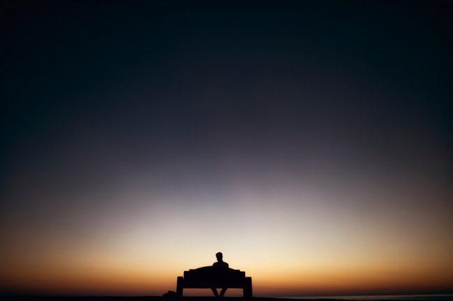 Lonely man illustrating night time loneliness